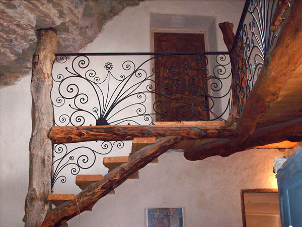 Balustrade, stair railings, wrought iron in a peacock form