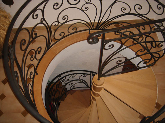 Spiral staircase, railings in wrought iron