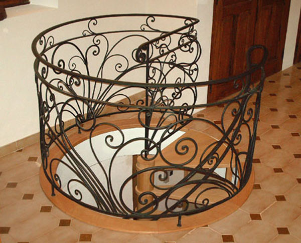 Balustrade for spiral staircase, in wrought iron