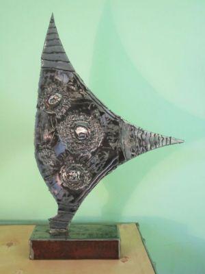 sculpture fer   environ    50 cm x 50 cm